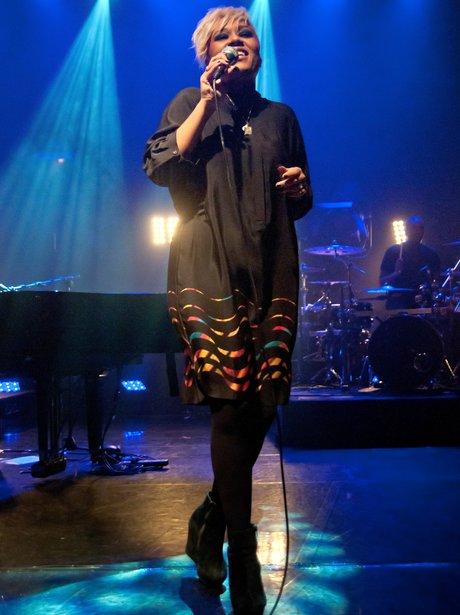 Emeli Sande performing on stage