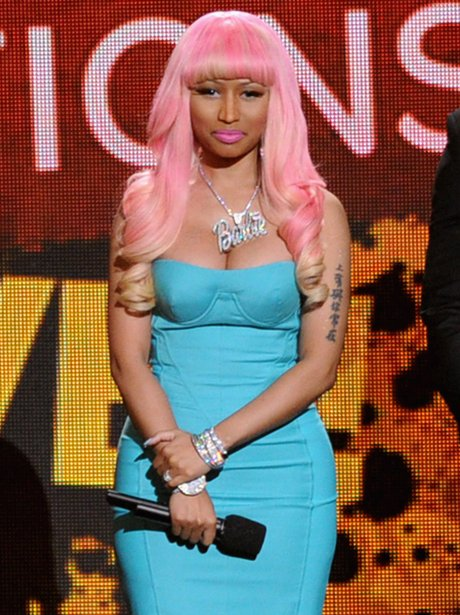 Nicki Minaj speaks onstage at the Grammy Nominations Concert