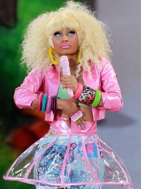 Nicki Minaj performs on stage in a pink leather jacket
