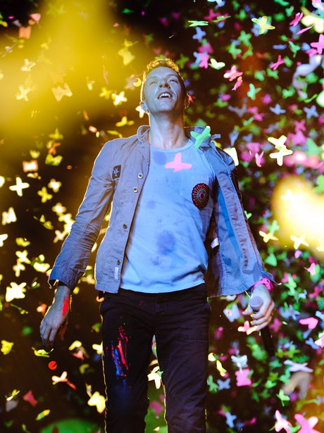 Coldplay performing live at Wembley Arena during The X Factor live final show in 2011