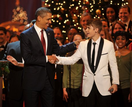 Justin bieber with Barack Obama on stage during a Christmas show in Washington