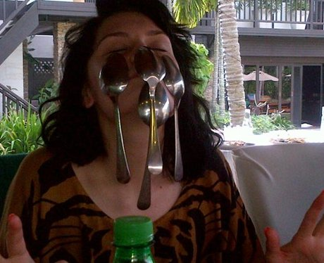 Jessie J sticking spoons on her face