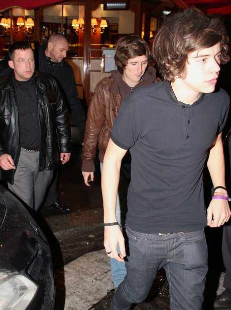 Harry Styles leaves a restaurant in Paris