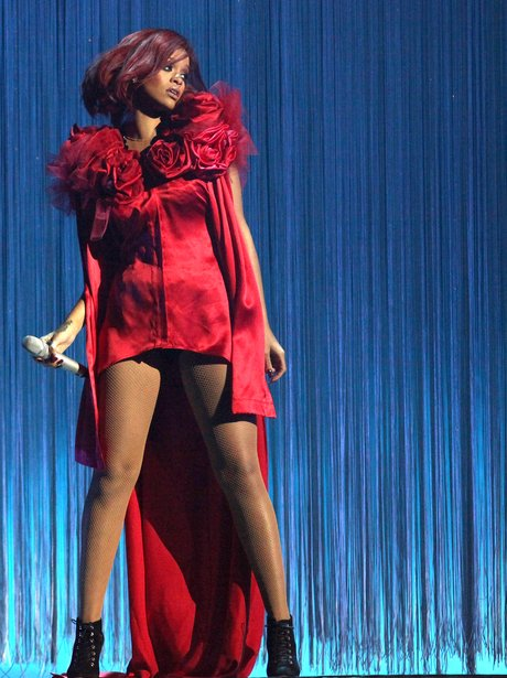 Rihanna performs on stage for the Brit Awards