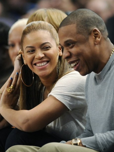 Beyonce and Jay-Z watching basketball
