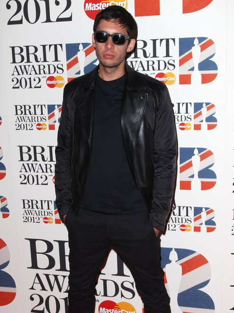 Example attends the BRIT Awards 2012