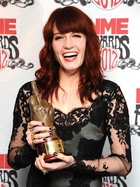 Florence Welch poses backstage at the NME awards.