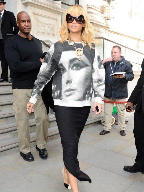 Rihanna in London wearing an jumepr with Elizabeth Taylors face on.