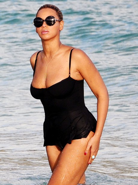 Beyonce in a black  swimsuit on the beach