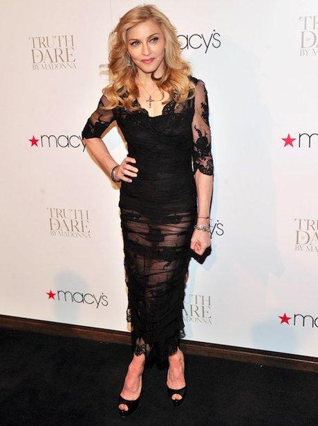 Madonna wearing a black dress