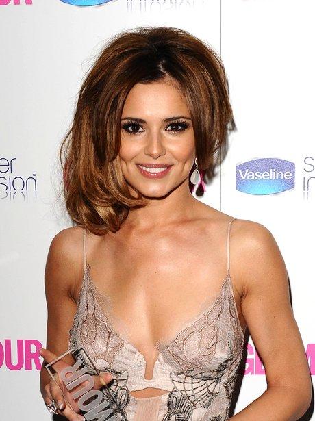 Cheryl Cole holding awards