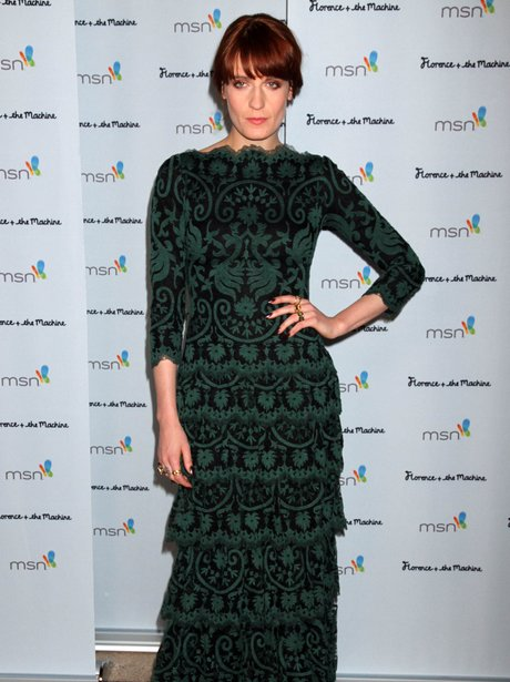 Florence Welch wears a long gren dress