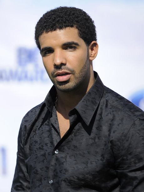 Drake poses on the red carpet