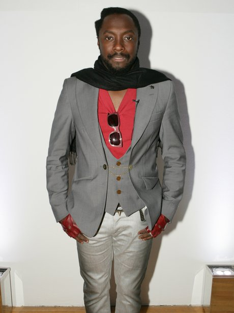 Will.i.am wearing a grey suit