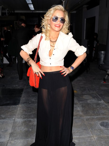 Rita Ora wearing a long black skirt.