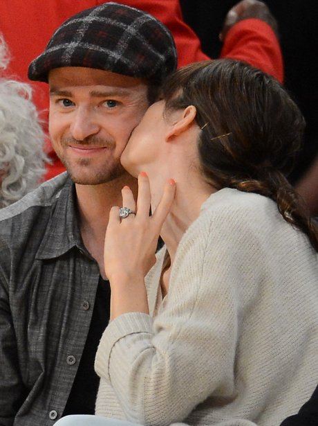 Justin Timberlake and Jessica Biel at a basketball game