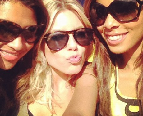 Mollie king wearing sunglasses