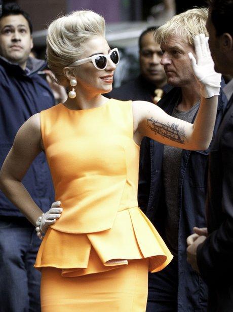 Lady Gaga greeting fans while on tour.