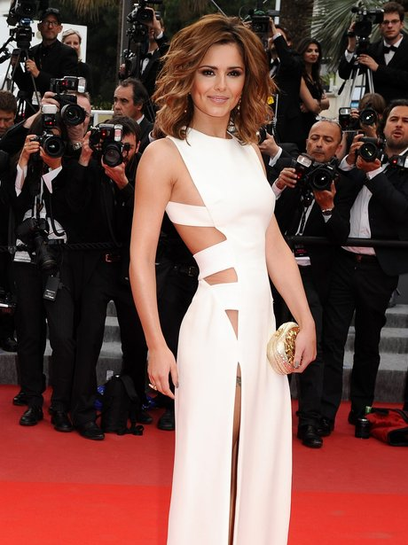 Cheryl Cole wears a white gown on the red carpet