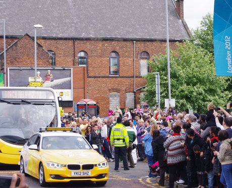 Crowd look forward to seeing the torch