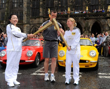 Smiles all round as torch arrives in Rochdale