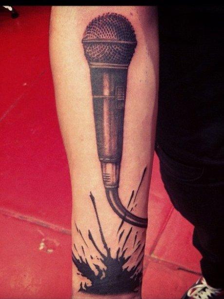 Zayn Malik shows off his microphone tattoo.