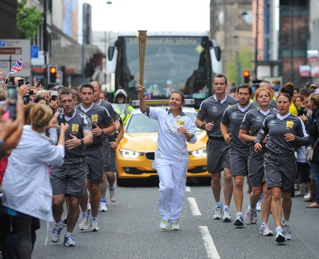 Torchbearer carries flame from Media City