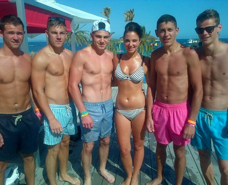 Tulisa poses in her bikini with fans on holiday
