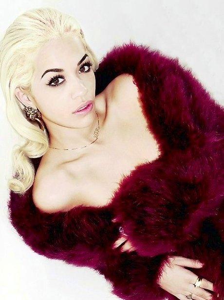 Rita Ora in a red fake fur gown.
