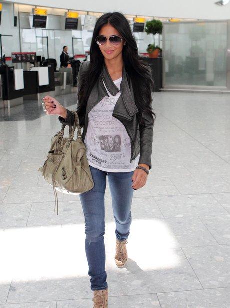 Nicole Scherzinger arrives back in the UK