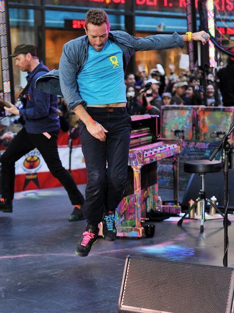 Coldplay live on stage.