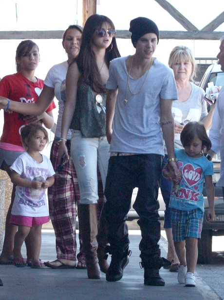 Justin Bieber with his sister and girlfriend Selena Gomez.