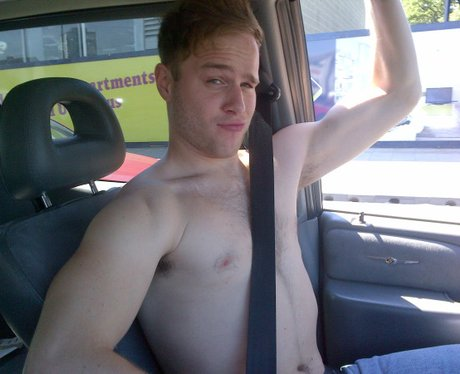 Olly Murs topless in a car