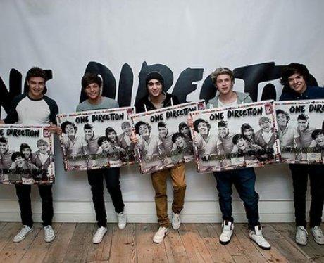 One Direction celebrate sales success.