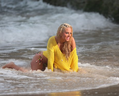 Tulisa films her new video on the beach.