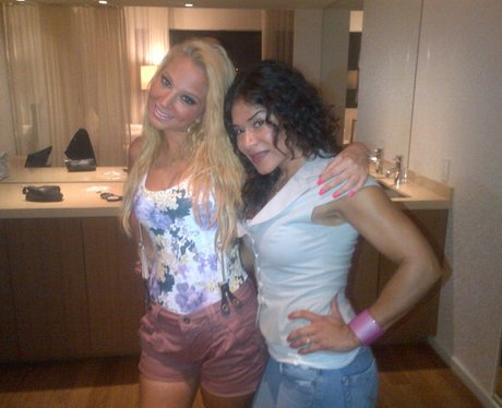 Tulisa poses with a friend