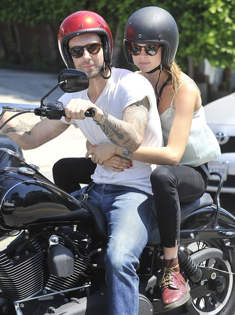 Adam Levine and Bhati Prinsloo on a motercyle