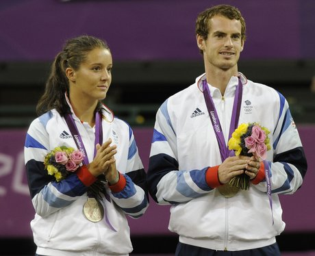 Andy Murray and Laura Robson celebrate their Olympic medals.