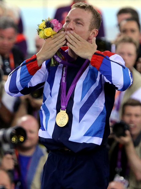 Chris Hoy celebrates winning a gold medal.