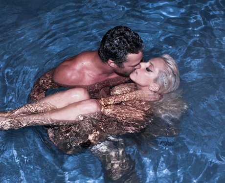 Lady Gaga and Taylor Kinney in a swimming pool.