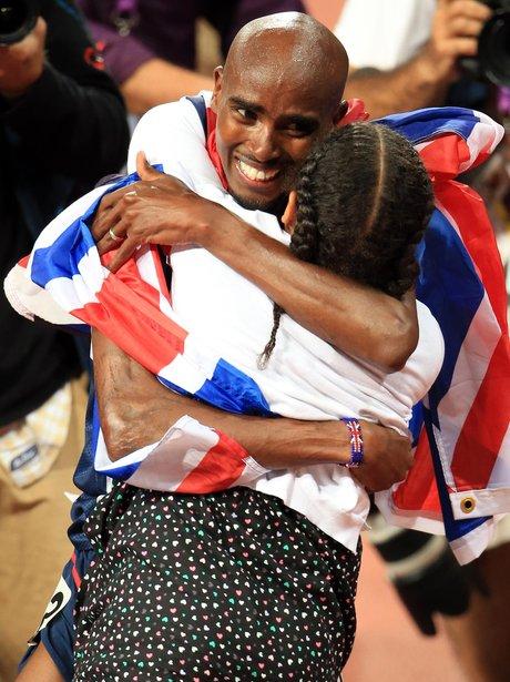 Mo Farah hugs his daughter at the Olympic Games.