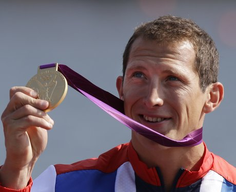 Ed McKeever displays his gold medal
