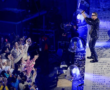 George Michael performs at the closing ceremony.