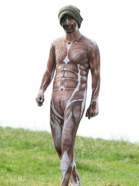 Harry Styles wearing a muscle morphsuit.