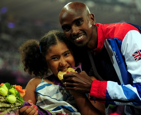 Mo Farah and daughter with gold medal