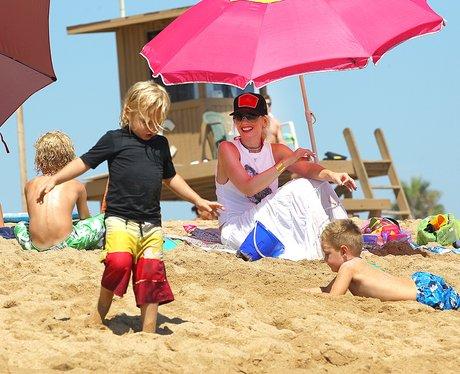 Gwen Stefani on the beach with her children