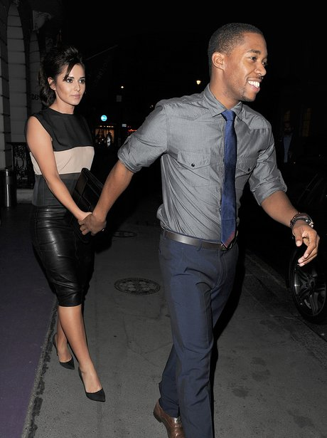 Cheryl Cole Tre Holloway holding hands