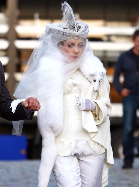 Lady Gaga wearing a fox fur scarf in Germany.