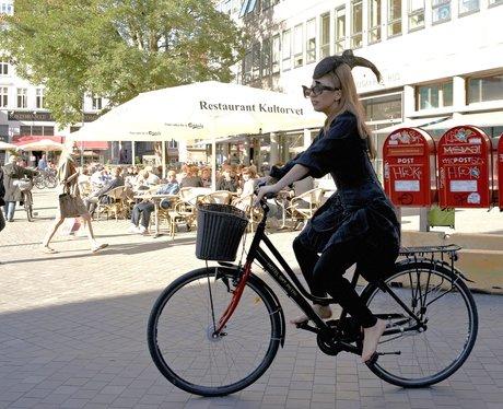Lady Gaga riding a bike
