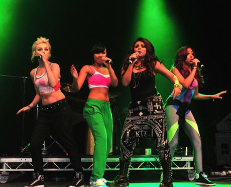 Little mix perform live on stage.